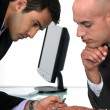 Two businessmen proof reading final draft of proposal — Stockfoto #16619559