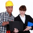 Architect and builder with a laptop — Stock Photo #16619851