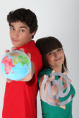 Teenagers with a globe and an @ symbol Dufour_Quentin_140410;Godreau_Lea_140410 — Stock Photo
