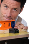 Closeup of a man using a laser lever — Stock Photo