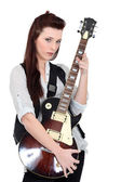 Brunette posing with electric guitar — ストック写真