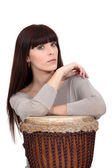 Woman with a djembe drum — Stock Photo