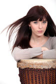 Attractive brunette with bongo — Stock Photo