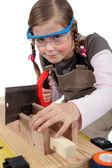 Schoolgirl dressed as joiner — Stock Photo