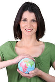 Woman holding small globe — Stock Photo