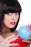 Portrait of a woman with globe — Stock Photo