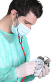 Nurse examining a clock — Stock Photo
