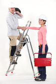 An electrician and his female apprentice. — Stockfoto