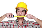 Craftsman working with a ruler meter — Stock Photo