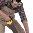 Stock Photo: Carpenter sawing.