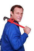 Worker with a pipe wrench — Stock Photo