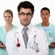 Doctor and interns — Stockfoto