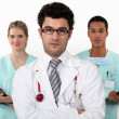 图库照片: Doctor and interns