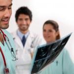 Nurse looking at ultrasound — Stock Photo #16630963