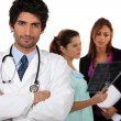 Stock Photo: Doctor with medical staff in background