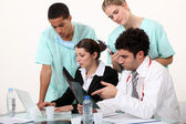Hospital staff analyzing a case — Stock Photo