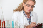 Woman in the laboratory — Stock Photo