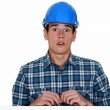 Confused young builder — Stock Photo