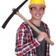 Smiling young mwith pickaxe — Stock Photo #16700639