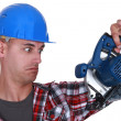 Builder holding circular-saw — Stockfoto #16709787