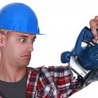 Builder holding circular-saw — Stock Photo