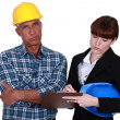 Stock Photo: Female architect and foreman