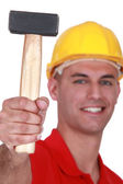 Manual worker proudly showing off hammer — Stock Photo