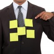 Businessman covered in blank sticky notes — Stock Photo