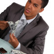 Businessman with briefcase full of money — Stock Photo #16723739