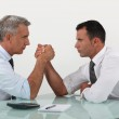 Businessmen arm wrestling — Stock Photo