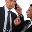 Man on the phone and writing assistant — Stock Photo #16748559