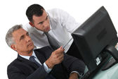 Duo of businessmen with computer — Stock Photo