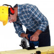 Stock Photo: Carpenter using band saw