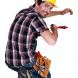 Tradesman using a pipe wrench — Stock Photo #16759355