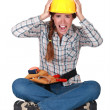 Portrait of a screaming tradeswoman — Stockfoto