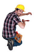 Tradesman using a pipe wrench — Stock Photo
