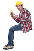 Young handsome electrician pointing at tester — Stock Photo