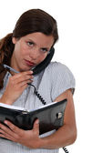 Receptionist scheduling an appointment — Stock Photo