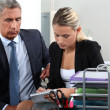 Stock Photo: Boss and secretary working together