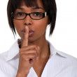 Woman doing a silence sign — Stock Photo