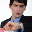 Businessman looking at his watch — Stock Photo #16761399
