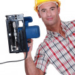 Carpenter displaying his new circular saw — Stock Photo #16761793