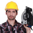 Stock Photo: Craftsmholding electric saw