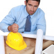Stock Photo: Architect with his fist on hard hat