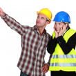 Scared architect stood with builder — Stock Photo #16763335