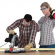 Carpenter with chainsaw — Stock Photo #16763355
