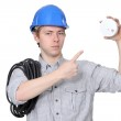 An electrician with a fire detector. — Stock Photo