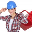 Female manual worker carrying tool box — Stock Photo