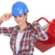 Female manual worker carrying tool box — Stock Photo #16763637