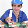 Portrait of young blue collar posing before model — Stock Photo #16763783